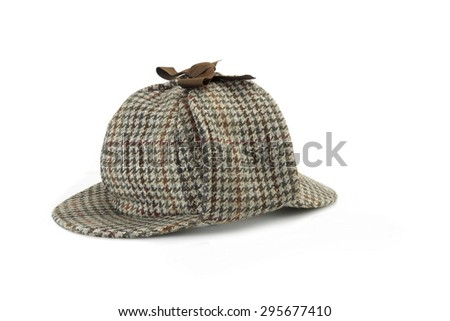 Close-up of Sherlock Holmes Deerstalker Cap Isolated Isolated On White Background. - stock photo