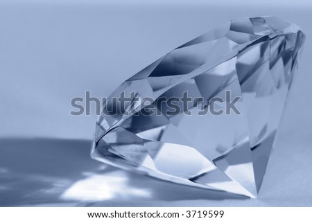Close-up of shiny diamond. Shallow DOF. Space for text. - stock photo