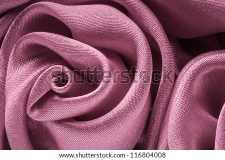 Close up of shiny light purple fabric rose shaped flower. - stock photo