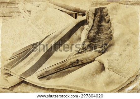 close up of shofar (horn) on white prayer talit. room for text. rosh hashanah (jewish holiday) concept . traditional holiday symbol. old style photo  - stock photo