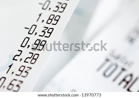 Close-up of shopping receipts with very shallow depth of field - stock photo
