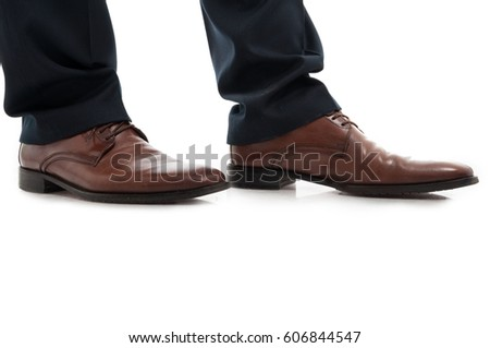 Close-up of side view leather brown elegant man shoes isolated on white background