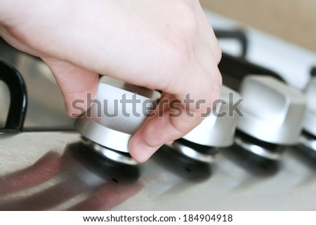 Close-up of silver cooker  button . - stock photo