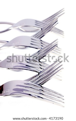 close-up of silver forks isolated on white - stock photo