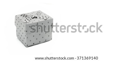 Close Up Of Single Gift Box With Dotted Black White Pattern, White Ribbon Ribbon And Bow, Isolated On White Background,  Horizontal Image With Copy Space, Front  View - stock photo
