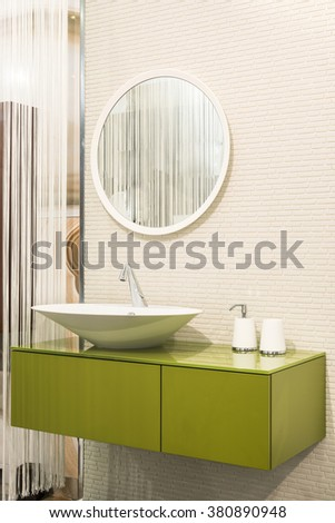 Close up of sink in bathroom interior