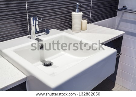 Close up of sink in new bathroom - stock photo