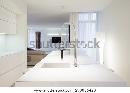 Close-up of sink in white kitchen interior - stock photo