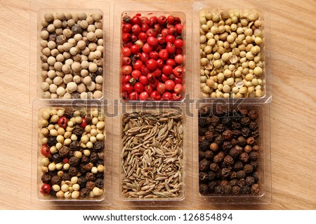 Close-up of six kinds of spices - stock photo