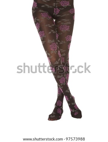 close up of slim female legs with stockings - stock photo