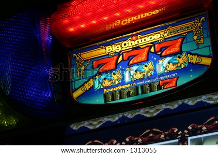 Close-up of slot machine with colorful lights