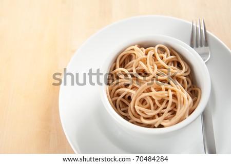 Close Up of Small Bowl Organic Whole Grain Spaghetti - stock photo