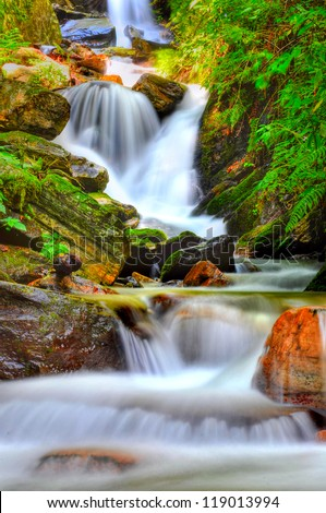 close up of small, mountain spring - stock photo