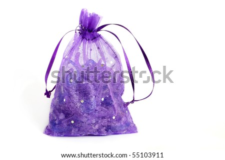 Close-up of small pouch filled with aromatic soap. - stock photo