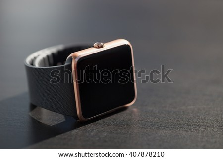 Close up of smart watch lying on the table. Copy space on the right - stock photo