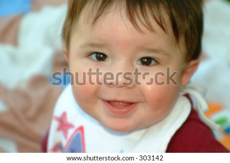 Close up of smiling baby boy with a small depth of field