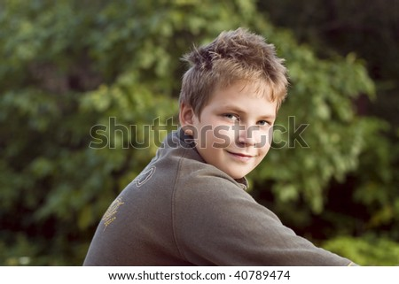 close-up of smiling boy walks in the park