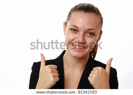 Close-up of smiling businesswoman showing thumbs up isolated