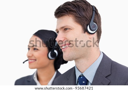 Close up of smiling call center team against a white background