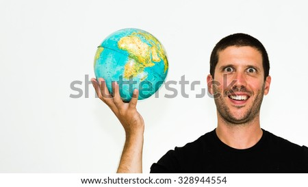 close-up of smiling caucasian man holding a world globe in his hand - conceptual image isolated on white background with copyspace