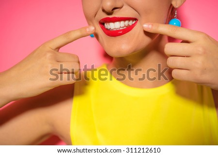 Close up of smiling face. Bright red lips make up. - stock photo