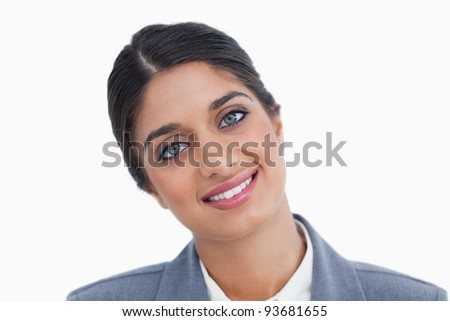 Close up of smiling female entrepreneur against a white background