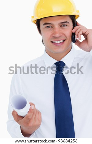 Close up of smiling male architect on his cellphone against a white background