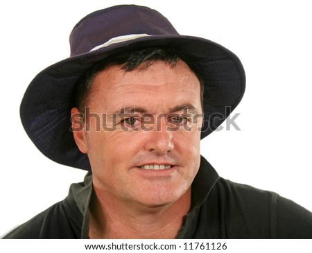 Close up of smiling middle aged man in a hat.