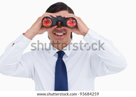 Close up of smiling tradesman looking through spy glass against a white background