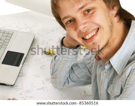 Close-up of smiling young businessman at his workplace