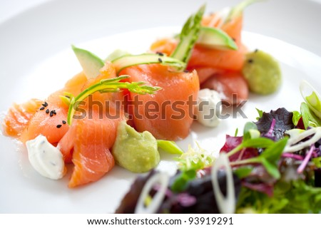 Close up of smoked salmon salad with green asparagus
