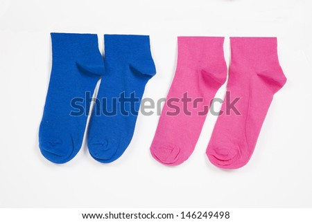 Close-up of socks hanging over white background - stock photo