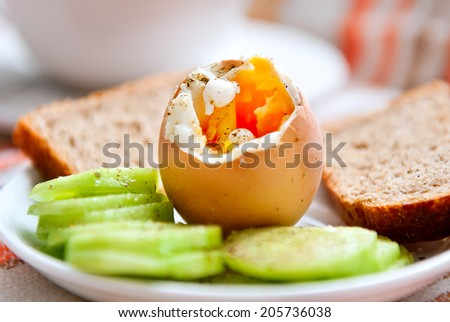 Close up of soft-boiled breakfast egg - stock photo