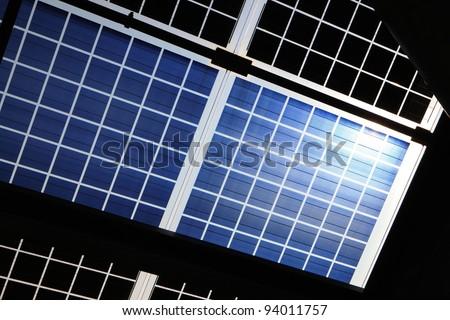 Close up of solar panel with sunshine - stock photo