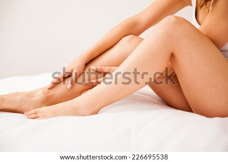 Close up of some beautiful and smooth legs from a young woman who just removed all hair - stock photo