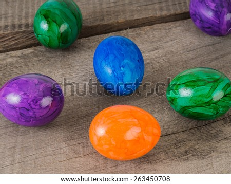 Close up of some beautiful colored easter eggs on a wooden table  - stock photo
