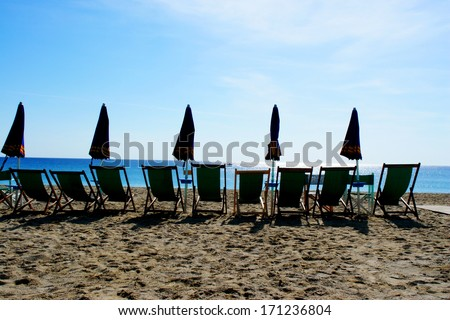 close up of some chairs for sunbathing - stock photo