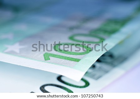 close up of some 100 euro bills