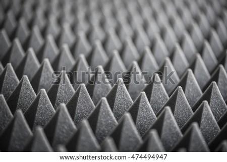 close up of sound absorbing sponge in recording studio dampening acoustical foam in music studio