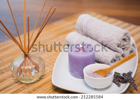 Close-up of spa objects on wooden table - stock photo