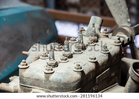 close-up of spark plug of old engine - stock photo