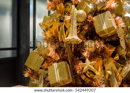 close up of sparkling golden christmas tree ornament