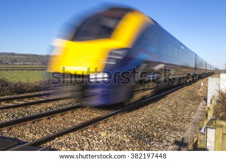 Close up of speeding train with extended exposure for motion blur - stock photo