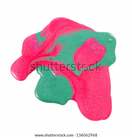 Close up of Spilled colorful nail polish - pink and light green - stock photo