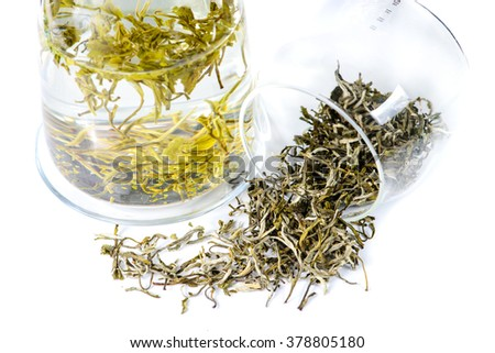 close-up of spilled tea Tea Huangshan Maofeng, shallow DOF - stock photo