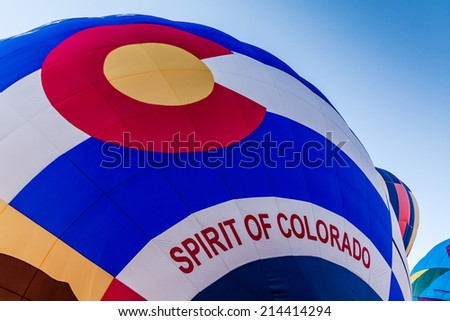 Close up of Spirit of Colorado hot air balloon being inflated before take off - stock photo