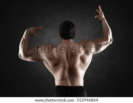 Close up of sports man's muscular back isolated