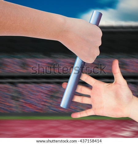 Close up of sportsman is holding a baton for a relay race - stock photo