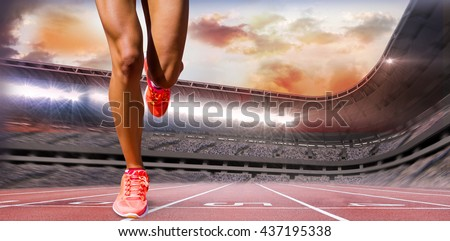 Close up of sportswoman legs against race track