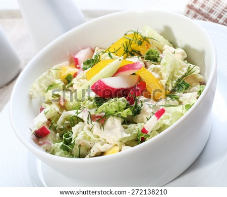 Close up of spring salad in bowl - stock photo
